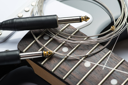 jacks: Guitar frets with strings, cable and jacks Stock Photo