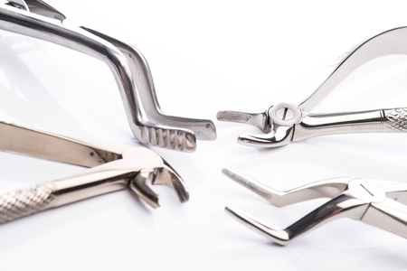 forceps: Pliers and extraction forceps on white surface