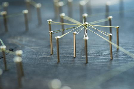individuals: Web of wires, showing connections between groups and individuals Stock Photo