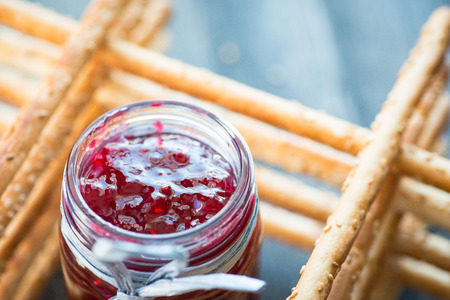 grissini: Bunch of homemade grissini breadsticks in a glass jar on wooden table Stock Photo