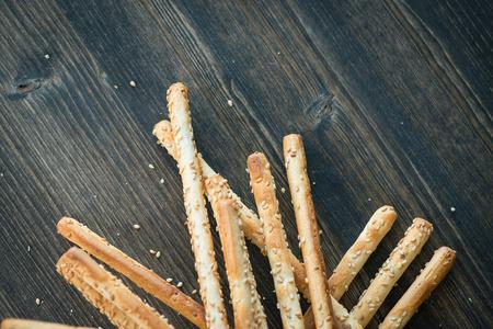 grissini: Bunch of homemade grissini breadsticks on wooden table