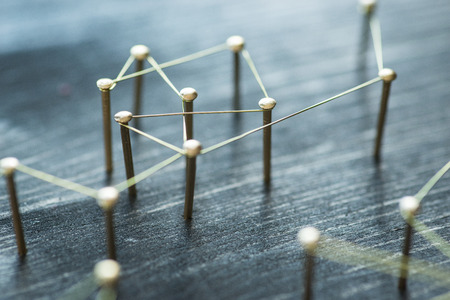 Web of wires, showing connections between groups and individuals Stock Photo