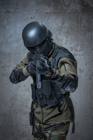 terrorism crisis: Terrorist soldier in helmet with automatic rifle in hands