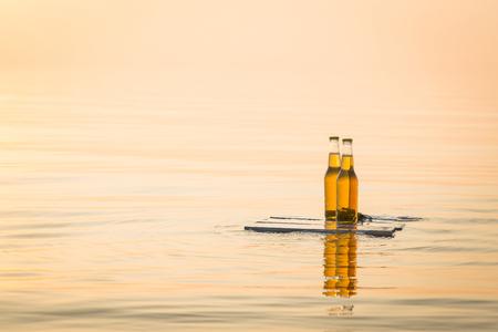 bottle opener: Beer bottles floating on the rustic wooden board Stock Photo