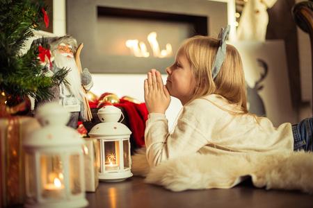 plaything: Christmas. Small girl asking santa for the gifts on christmas Stock Photo