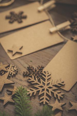 Christmas. Gifts. Cardboard vintage name tags on a string Standard-Bild