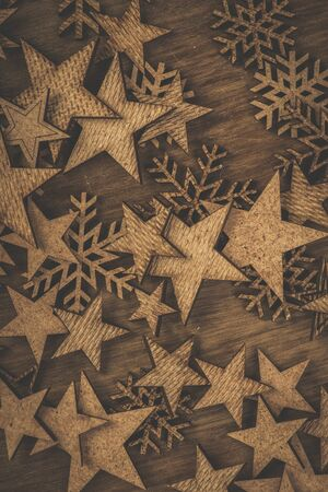 Christmas. Decoration. Stars and snowflakes on a rustic wooden table