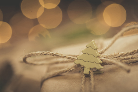 Christmas. Gifts. Vintage style fir tree decor with bokeh lights behind