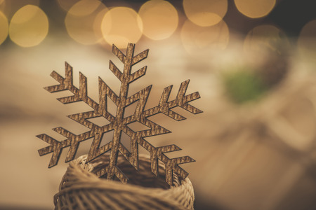 Christmas. Gifts. Vintage style snowflake with bokeh lights behind