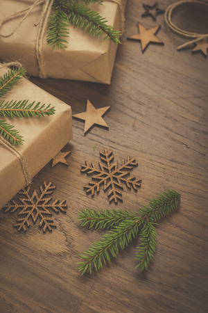 Christmas. Gifts. Vintage style gift boxes on a rustic wooden table Standard-Bild