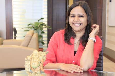 India, Maharashtra, Pune, Portrait of happy woman indoors
