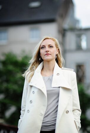 Portrait of business woman standing on street