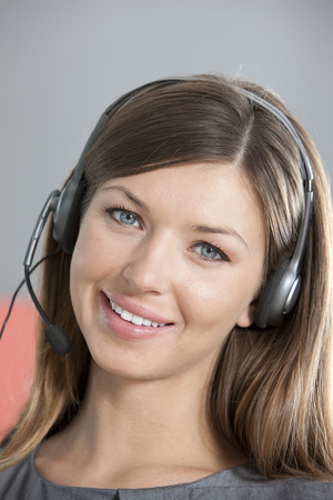 Portrait of woman smiling wearing headset