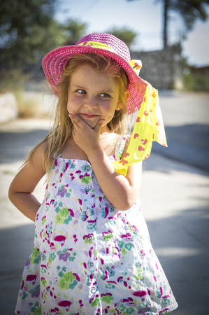 sunhat: Front view of girl wearing summer hat LANG_EVOIMAGES