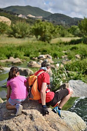 Teenage boy and girl (12-13, 8-9) hiking