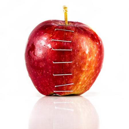 stapled: Apple stapled together LANG_EVOIMAGES