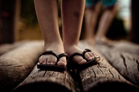 flip flops: Close up of feet in flip flops LANG_EVOIMAGES