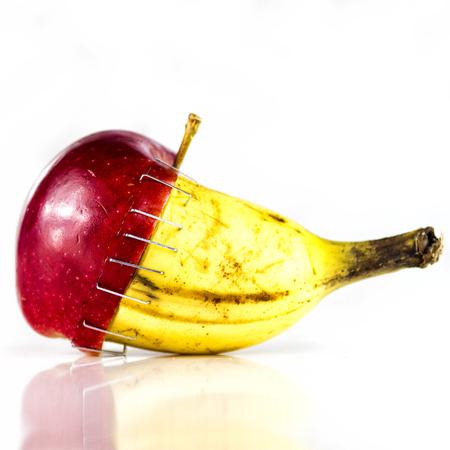 stapled: Apple and banana stapled together