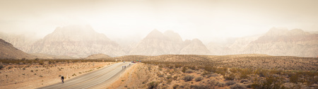 nevada: USA, Nevada, Clark County, Bonnie Springs, Red Rock Canyon National Conservation Area, Mountain range and bikers on road