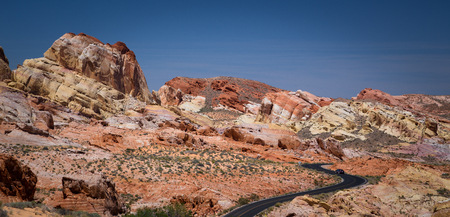 nevada: USA, Nevada, Clark County, Lone car on curved road in Valley or Fire State Park