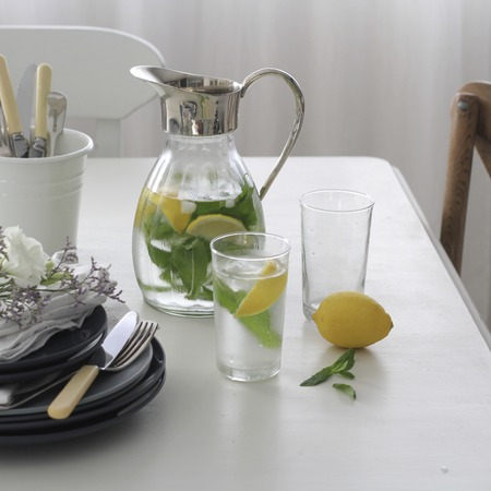 infused: Jug and glass of water infused with fresh lemon and mint