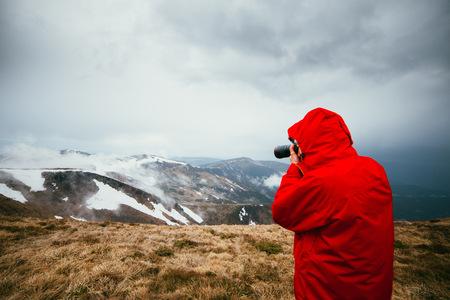 Man photographing landscape