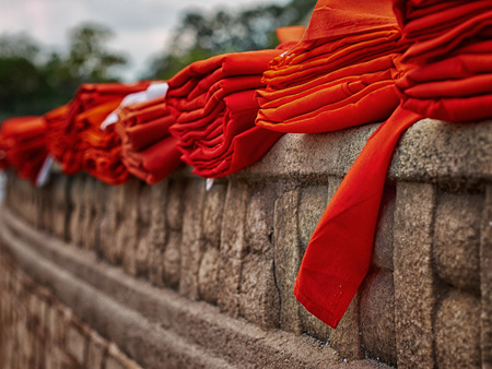 religious clothing: Sri Lanka, Anuradhapura, Red monks robes on fortified wall