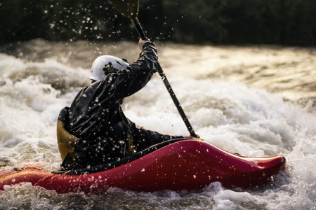 paddles: USA, Colorado, Clear Creek, Close-up shot of man kayaking in white water