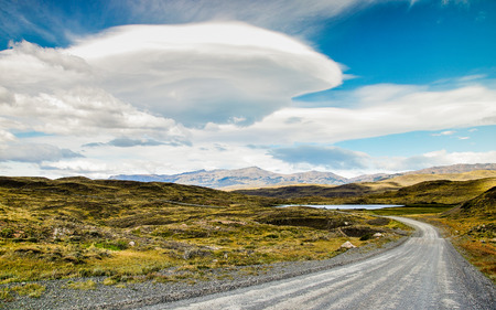 lenticular: Chile, Torres del Paine national park, Lenticular cloud above dirt road LANG_EVOIMAGES