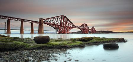 UK, Scotland, Edinburgh, Queensferry, Low angle view of Forth Rail Bridge at dawn