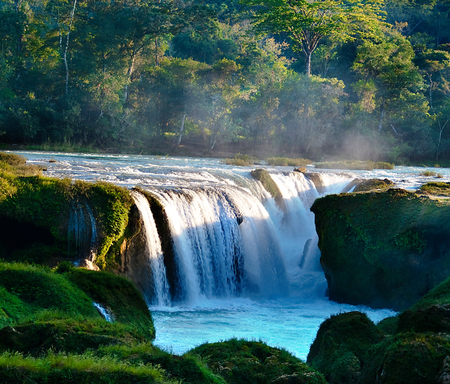 Mexico, Chiapas, Montes Azules Biosphere Reserve, Lacandon Jungle, Santo Domingo River, Las Nubes, Waterfall with mossy rocks in foreground LANG_EVOIMAGES