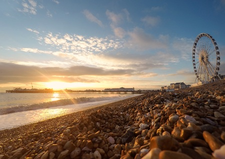 brighton: UK, England, East Sussex, Brighton beach at sunset LANG_EVOIMAGES