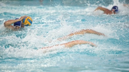 People playing waterpolo in swimming pool LANG_EVOIMAGES
