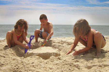 Three siblings (6-7, 8-9, 10-11) on beach