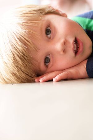only boys: Portrait of young boy (4-5) laying down LANG_EVOIMAGES