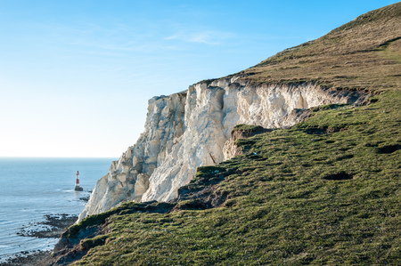 head protection: United Kingdom, England, East Sussex, Beachy Head lighthouse with Seven Sisters cliff in foreground LANG_EVOIMAGES