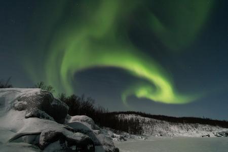Sweden, Kiruna, Aurora Borealis above Frozen Lake of Tornetrask