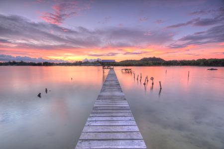 Malaysia, Sabah, Tuaran, Gayang Village, View of jetty and lake at dusk