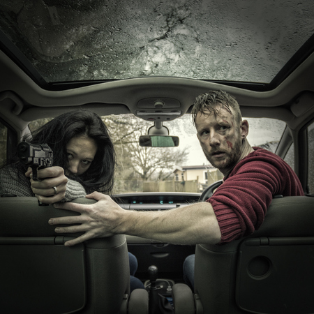 head protection: Couple in car with gun LANG_EVOIMAGES