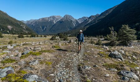 one mature man only: Man hiking in the Waimakariri River Valley, New Zealand LANG_EVOIMAGES