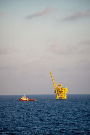 Supply ship leaving an oil and natural gas platform
