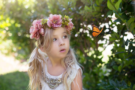 Girl watching a butterfly