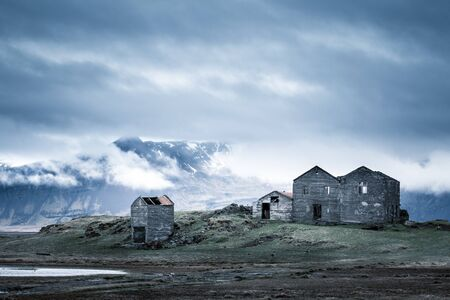 Ruins of an abandoned Farm House at the foot of a mountain, Iceland