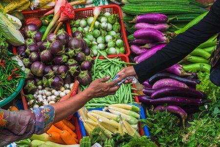 Woman shopping at market, Kota Bharu, Kelantan, Malaysia