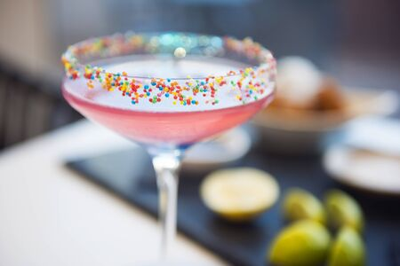 hundreds: Colorful cocktail decorated with hundreds and thousands on the rim LANG_EVOIMAGES