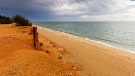 Empty beach, Faro, Portugal LANG_EVOIMAGES