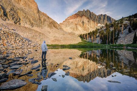 Man standing by Lake, Inyo National Forest, California, America, USA
