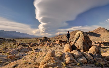 Man standing on a rock, Alabama Hills, Inyo County, California, USA LANG_EVOIMAGES