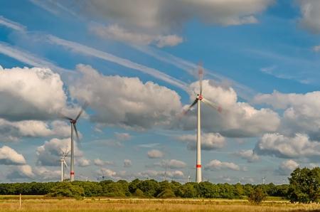 Wind turbines in a field near Stikelkamperfehn, Lower Saxony, Germany LANG_EVOIMAGES