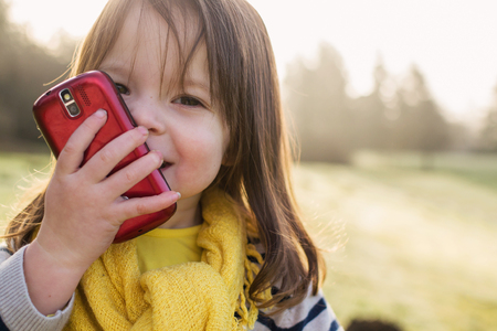 Smiling girl talking on a mobile phone